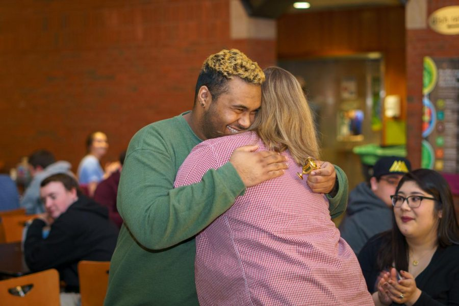 Presidential Candidates Molly Aldrich and Riaz Clark embrace as the election results are announced.