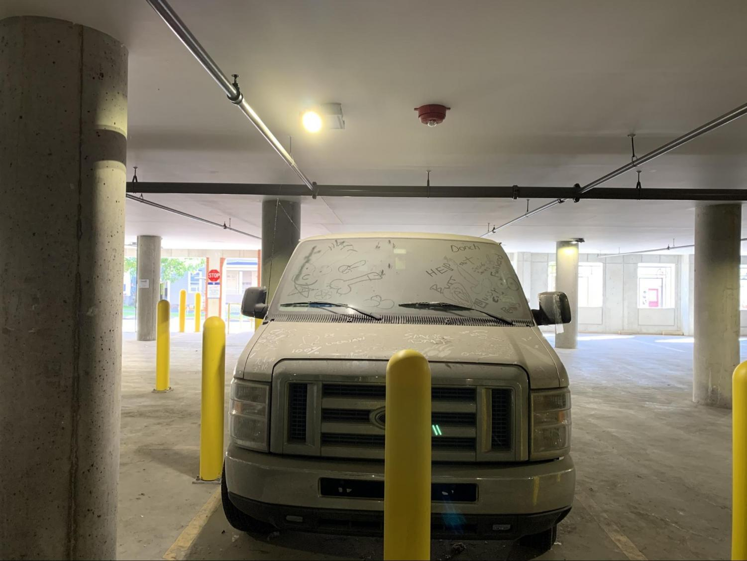 This white van hasn't moved from the Maple Street parking garage under 194 St. Paul Street since early this summer. Students have graffitied in the dust accrued on the body.