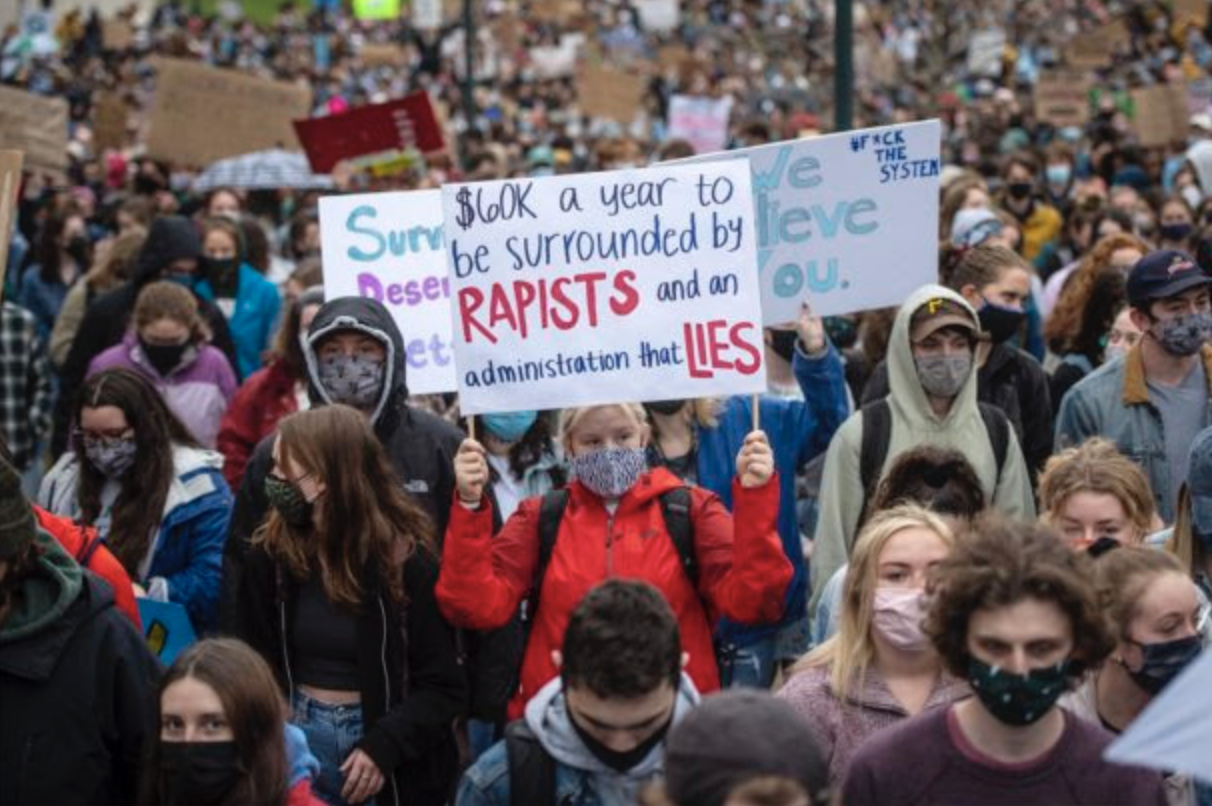 Students protest UVM's failure to protect survivors. Photo: Glenn Russell for VTDigger.