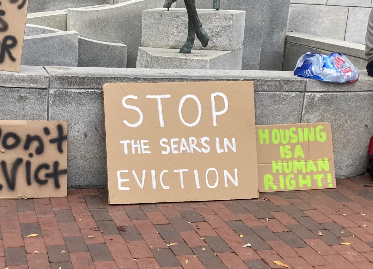 Signs seen outside City Hall during the protest on Oct 17. Photo: Bel Kelly for the Crossover.